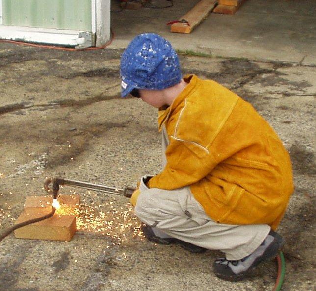 teenager welding