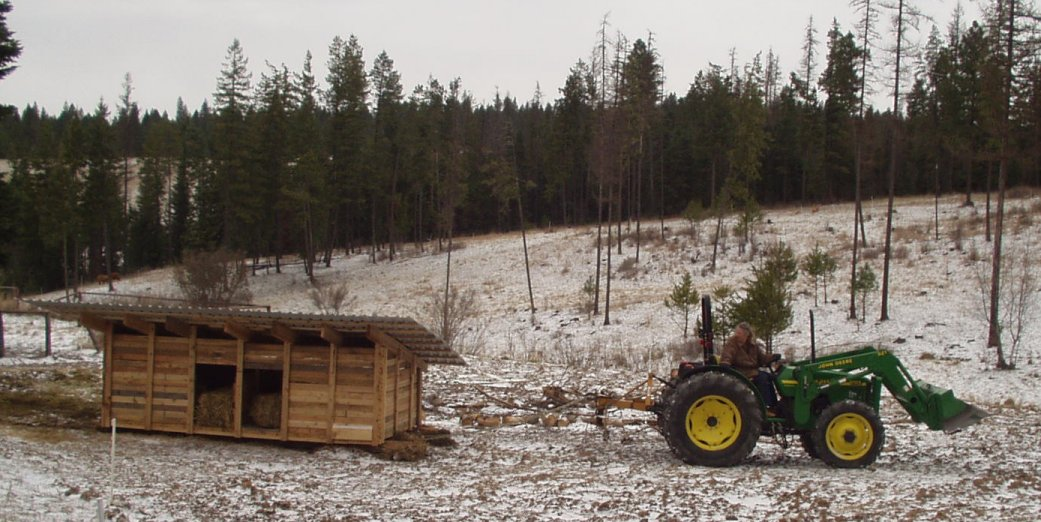 towing pig farrowing hut with a small tractor